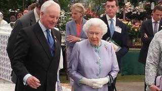 Raymond Evison showing Queen Elizabeth II the Guernsey Clematis display at RHS Chelsea 2014