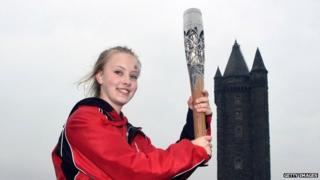 Emily holds the Commonwealth Games Baton