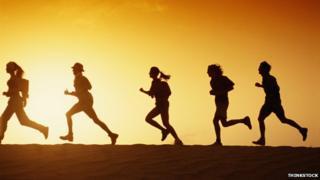 Runners in profile in the desert