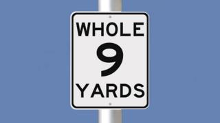 Whole 9 yards sign