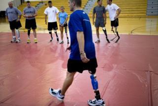 Veterans practice walking with prosthetics