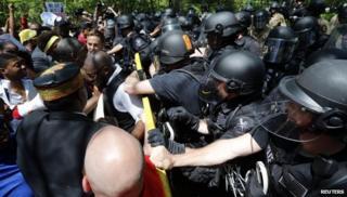 Police officers arresting protestors