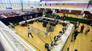 Vote counters are hard at work at the Antrim and Newtownabbey count in the Valley Leisure Centre, Newtownabbey