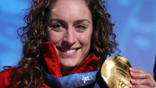 Amy Williams, MBE, with her Olympic gold medal