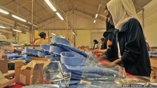 A worker packages dress shirts on the assembly floor at the Italian-owned Dolce Vita textile factory, in Eritrea.