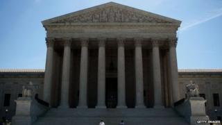 Two guards stand in front of the U.S. Supreme Court in Washington DC 12 June 2008