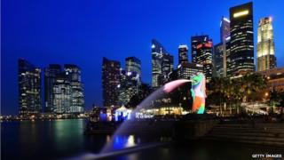 A general view of the Merlion and the central business district skyline on 28 March 2012 in Singapore.