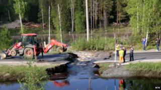 Road washed away due to beaver dam