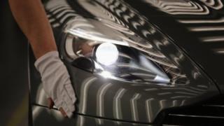 Aston Martin Vanquish inspected by hand