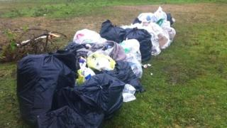 Rubbish bags at the site on Summerdown