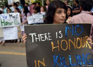 Pakistani human rights activists hold placards during a protest in Islamabad on May 29, 2014 against the killing of pregnant woman Farzana Parveen was beaten to death with bricks by members of her own family for marrying a man of her own choice in Lahore
