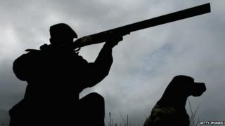 man with rifle grouse shooting