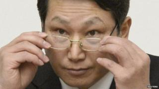 South Korean missionary, identified by the North as Kim Jong-uk, adjusts his glasses during a news conference in Pyongyang on 27 February 2014