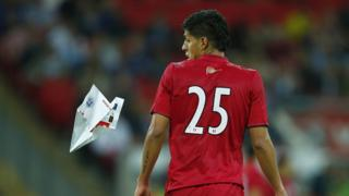Peru defender Hansell Riojas surprised by a paper plane