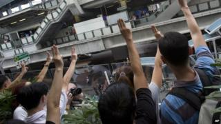 Anti-coup protesters flash three-fingered in central Bangkok on 1 June 2014