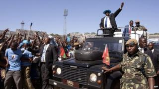 Malawi's new President Peter Mutharika waves at people at the Kamuzu stadium in Blantyre on 2 June 2014