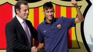 "FC Barcelona's new player Brazilian Neymar da Silva Santos Junior (R) poses with Barcelona""s President Sandro Rosell at Camp Nou stadium in Barcelona, on June 3, 2013"