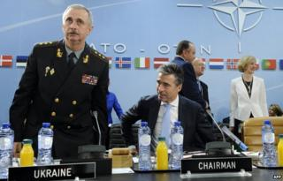 """Acting Ukrainian Defence Minister Mykhailo Koval (L) and North Atlantic Treaty Organization (NATO) Secretary General Anders Fogh Rasmussen arrive for a defence ministers"""" meeting at the NATO headquarters in Brussels on June 3"""
