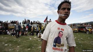 Man smoking at political rally in East Timor, 2007