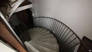 The staircase to the cellar of an apartment building, where the dead bodies of five babies were found