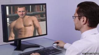 A designer digitally manipulating an image of Assad.