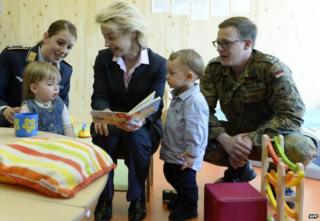 German Defence Minister Ursula von der Leyen meets children at the opening of an army nursery in Munich, 12 May