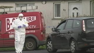 Forensic officers were called to the scene where the woman's body was discovered