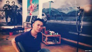 This portrait photo taken by Chinese artist Guo Jian, shows him in his studio