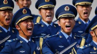 Soldiers from the honour guards of the Chinese Army shout as they march during a welcoming ceremony for Kuwait's Prime Minister in Beijing, June 3