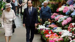 The Queen was shown around the flower market by French President Francois Hollande.