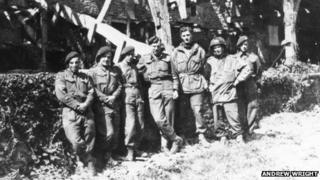 Maj John Howard (centre) with soldiers in Normandy, 1944