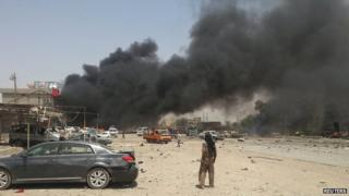 Smoke rises from the site of a car bomb attack in the town of Tuz Khurmatu, north of the capital Baghdad