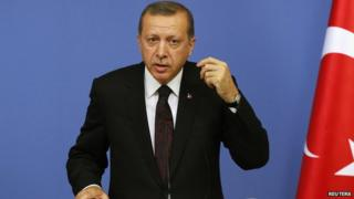 Turkish Prime Minister Tayyip Erdogan reacts during a news conference in Ankara June 9