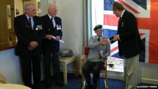 D-Day veteran George Paltridge being presented with