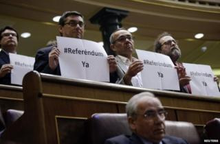 Plural Left MPs hold up placards in parliament calling for a referendum, 11 June