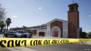 Police tape stretched outside the Mother of Mercy Mission Catholic church in Phoenix, Arizona, on 12 June 2014