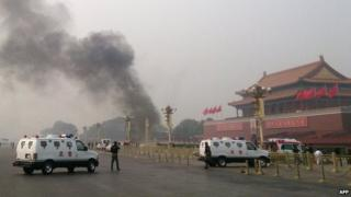 File photo: Police cars blocking off the roads leading into Tiananmen Square as smoke rises into the air after a vehicle loaded with petrol crashed in front of Tiananmen Gate in Beijing, 28 October 2013