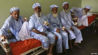 Elders with bandaged hands after their fingers were allegedly cut off by the Taliban for voting. 15 June 2014