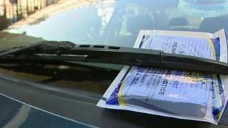 A parking ticket on a car windscreen