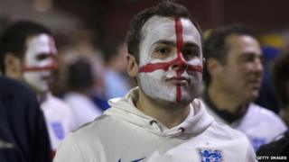 A disappointed England fan leaves Arena de Sao Paulo stadium after the defeat against Uruguay (19 June 2014)