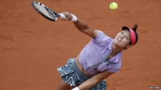 Li Na serving during the French Open championship