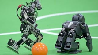 Robots competing in the RoboCup