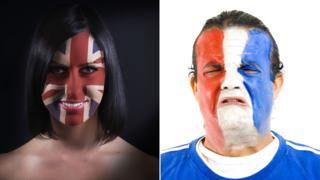 Woman with Union Flag on her Face and man with French flag on face