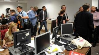 Journalists gathered at the Wprost office in Warsaw to record the raid - 18 June 2014