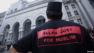 A Muslim man stands outside the court in Putrajaya outside Kuala Lumpur on 23 June 2014