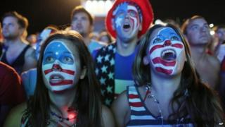 Fans with their faces painted with the US national soccer team's colours, watch a live telecast of the group G World Cup match between United States and Portugal, inside the FIFA Fan Fest area on Copacabana beach, in Rio de Janeiro, Brazil 22 June 2014