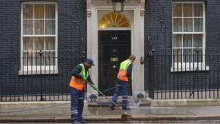 Cleaners outside 10 Downing Street