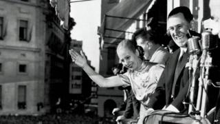 Argentine President Juan Peron, and his wife Eva, wave from the balcony of Casa Rosada in Buenos Aires on 17 October 1950 as his supporters celebrated Loyalty Day