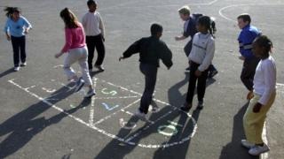 Older primary pupils in playground