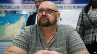 Alexander Matusov is presented to the media during a press conference at Thailand's immigration offices in Bangkok, 25 June 2014